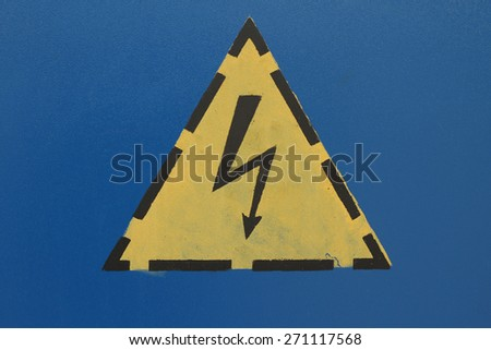 High voltage sign on the blue wall abstract background - stock photo