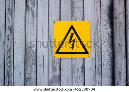 High voltage sign on the wooden door
