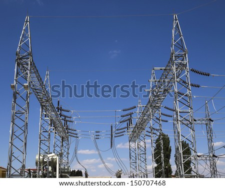 high voltage substation - cloudy blue sky. - stock photo