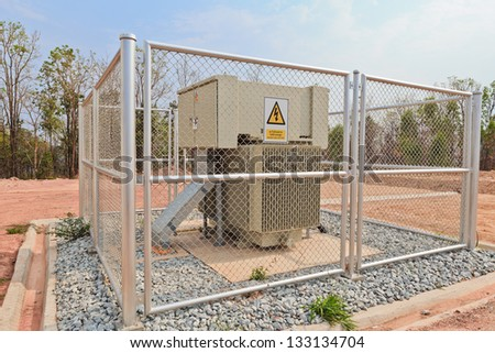high-voltage substation in a metal fence - stock photo