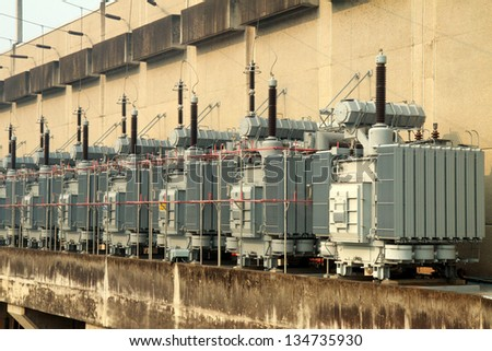 High-voltage substation power transformer at water power plant in sirigit Dam,Thailand - stock photo