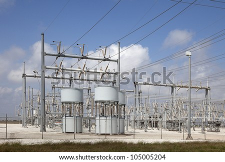 High Voltage Substation with the Blue Sky Background. - stock photo