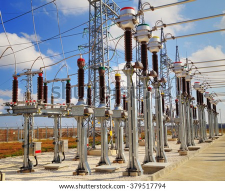 High voltage switch-yard in electrical substation - stock photo
