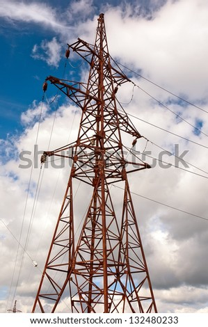 High-voltage tower against the sky