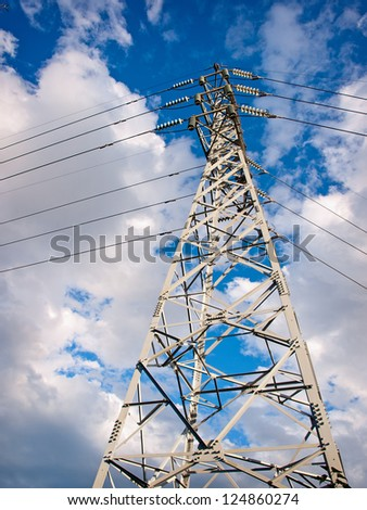 High voltage tower and power lines against sky - stock photo