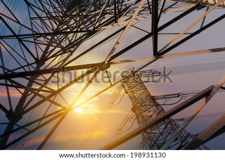 High voltage tower at sunset