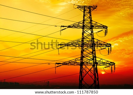 High voltage tower, in the evening sky background, - stock photo