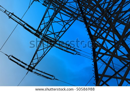 High voltage tower on blue sky background - stock photo