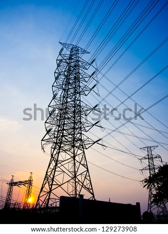 High-voltage tower on sun set sky background.