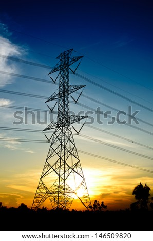 High-voltage tower on twilight background.