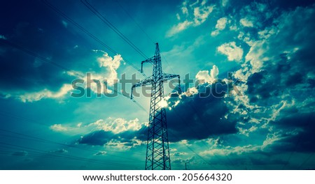 High-voltage tower with dramatic sky background - stock photo