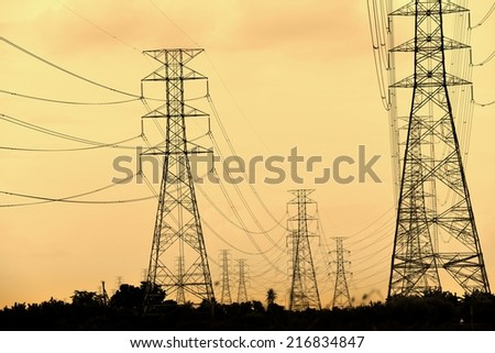 High voltage towers against the sunset background