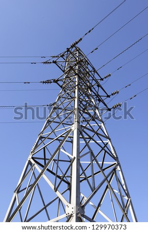 High voltage towers in the background of blue sky