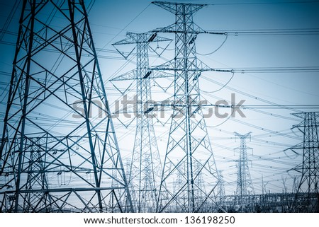 High voltage towers with sky background. blue toned images. - stock photo