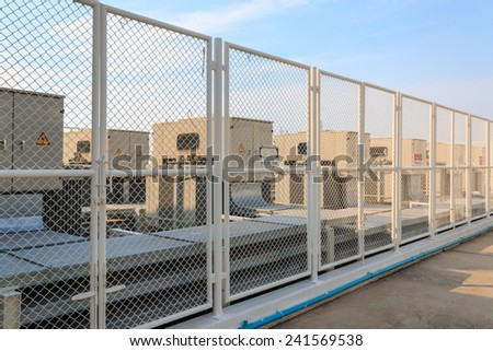 High Voltage Transformers And Sky - stock photo