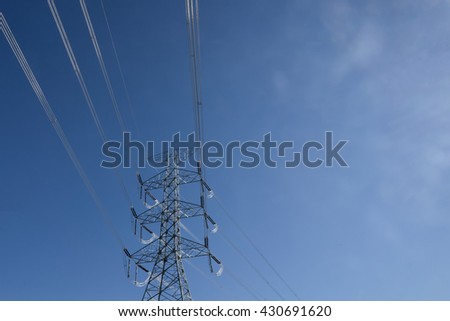 High-voltage transmission lines are used to transmit electric power over relatively long distances, usually from a central generating station to main substations - stock photo