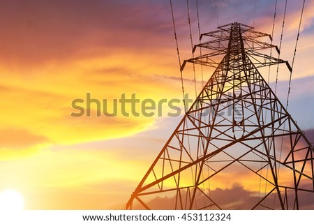 High Voltage transmission tower at twilight time.