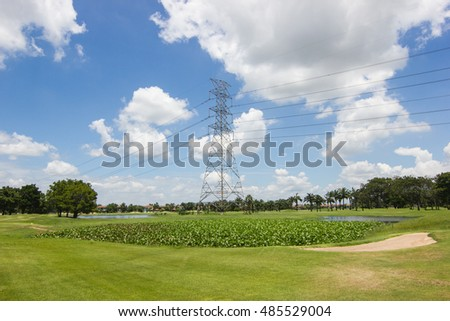 High voltage transmission towers, Background sky blue - Green grass THAILAND