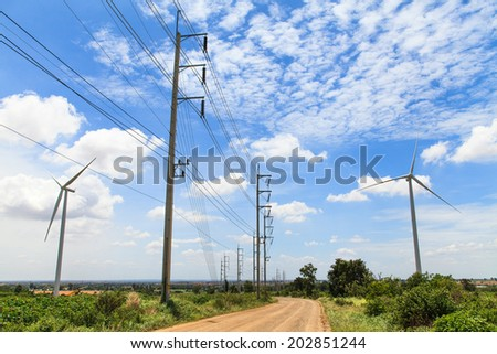 High voltage with wind turbine - stock photo
