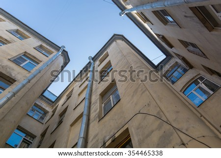 high walls with windows stretching up against the blue sky