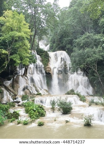 high waterfall in forest of laos