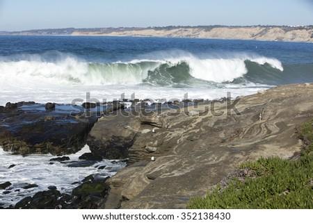 High waves cresting and hitting the coastline at La Jolla California - stock photo