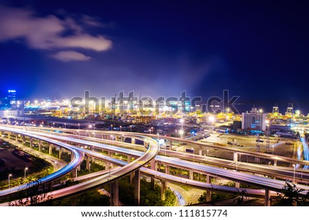 high way beside barbor at night - stock photo