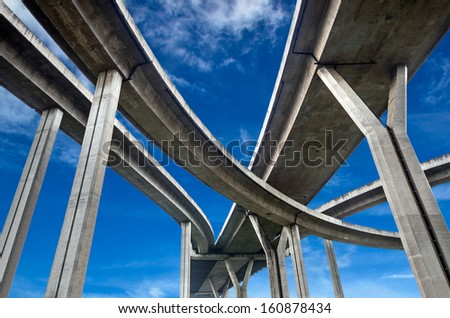 High way under blue sky - stock photo