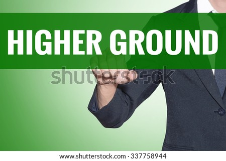 Higher Ground word Business man point on green tab virtual screen - stock photo