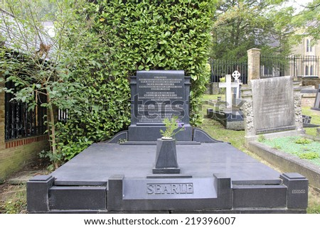 HIGHGATE, LONDON - SEPTEMBER 23, 2014:  Headstone. Highgate Cemetery is notable both for some of the famous people buried there as well as for its status as a nature reserve.