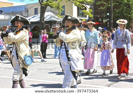 Highland Park, IL, USA - July 4, 2014: American Revolutionary War reenactors march in the Independence Day 4th of July Parade.  - stock photo