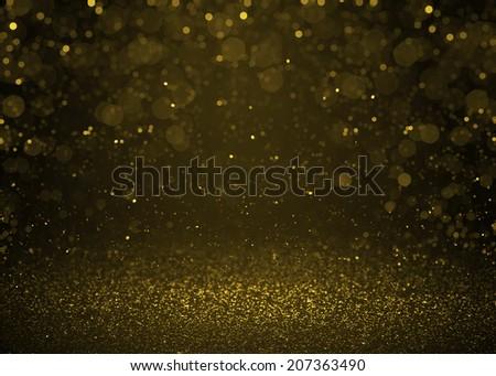 Highlighted bokeh gold sparkle glitter background. Defocused glitter stars background - stock photo
