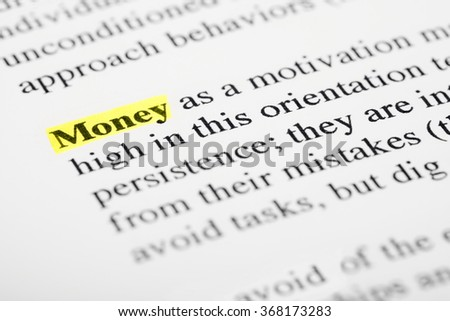 "Highlighted text of ""money"". Selective focus with macro lens."