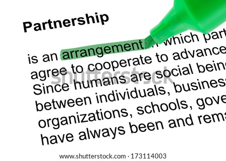 Highlighted word arrangement for Partnership with green pen over white paper. Isolated white background.