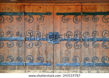 Highly decorated gate of an old building , Tirol, Austria