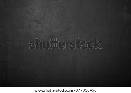 Highly detailed and empty black concrete wall. Dark background, horizontal - stock photo