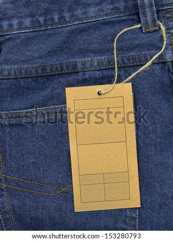 Highly detailed closeup of blue denim pocket with paper tag