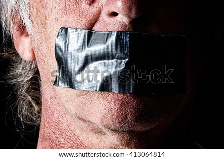Highly detailed creepy image of man with mouth duct taped closed. Political correctness or freedom of speech concept. - stock photo
