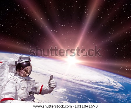 Highly detailed epic sunrise from space. Astronaut flying. The elements of this image furnished by NASA.