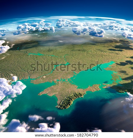 Highly detailed fragments of the planet Earth with exaggerated relief, translucent ocean and clouds, illuminated by the morning sun. Black Sea and Crimea. Elements of this image furnished by NASA - stock photo