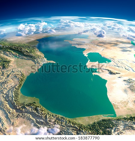 Highly detailed fragments of the planet Earth with exaggerated relief, translucent ocean and clouds, illuminated by the morning sun. Caspian Sea. Elements of this image furnished by NASA - stock photo