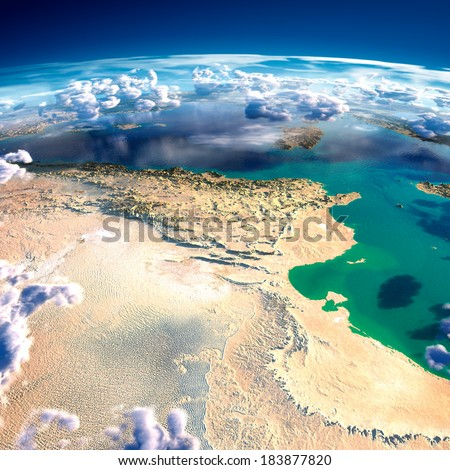 Highly detailed fragments of the planet Earth with exaggerated relief, translucent ocean and clouds, illuminated by the morning sun. Tunisia. Elements of this image furnished by NASA - stock photo