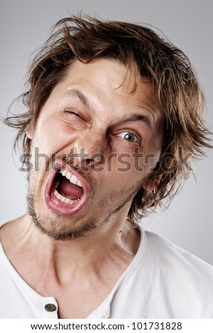 Highly detailed image of a funny face young attractive man (more than 100 faces in this  collection in my portfolio) - stock photo