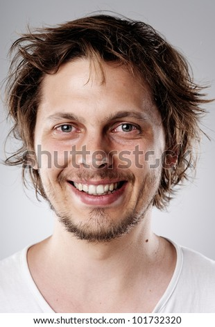 Highly detailed image of a happy smiling young attractive man (more than 100 faces in this collection in my portfolio) - stock photo