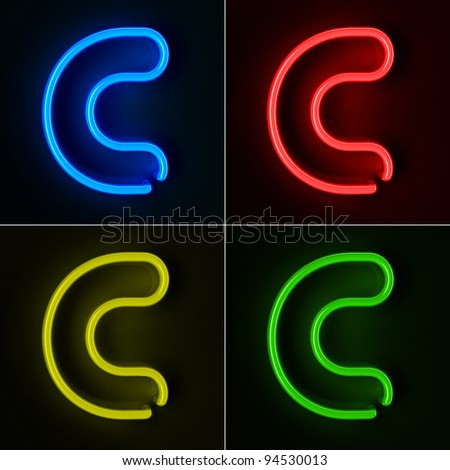 Highly detailed neon sign with the letter C in four colors - stock photo