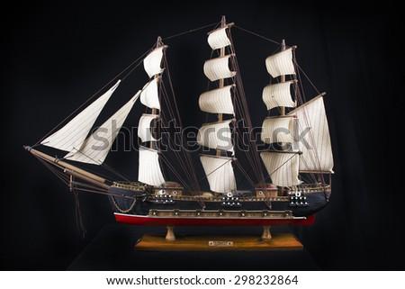 Highly detailed XVIII century frigate model isolated over black background - stock photo