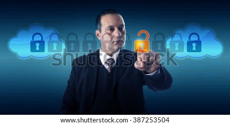 Highly focused businessman is unlocking a data packet within an intercloud information stream. Technology management, internet security, service provider interoperability and cloud computing concept. - stock photo