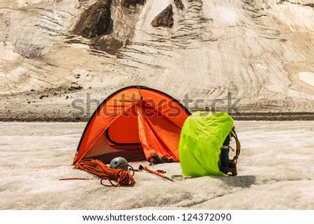 Highly in mountains there is tent of climbers - stock photo