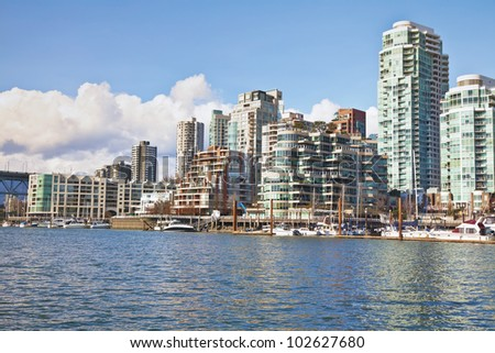 Highrise apartment and condo buildings on the waterfront of Vancouver, British Colombia.