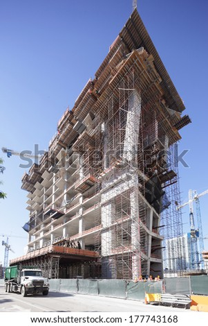 Highrise building under construction - stock photo